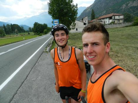 Cycling along the flat road with Mountains all around, and me sporting some very bad helmet hair
